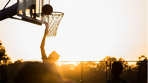 basketball played at dusk