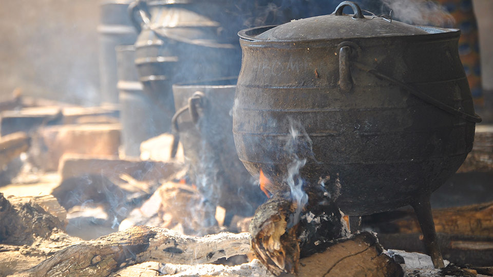 A pot cooking on wood fuel.
