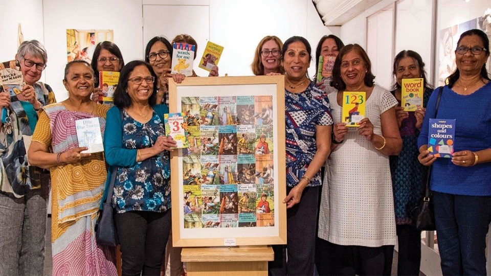 photo of a group of women holding Ladybird Books and facing the camera