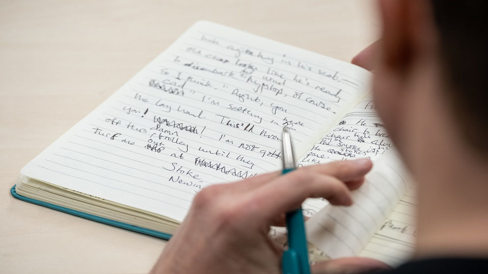 photo of notebook with handwriting in