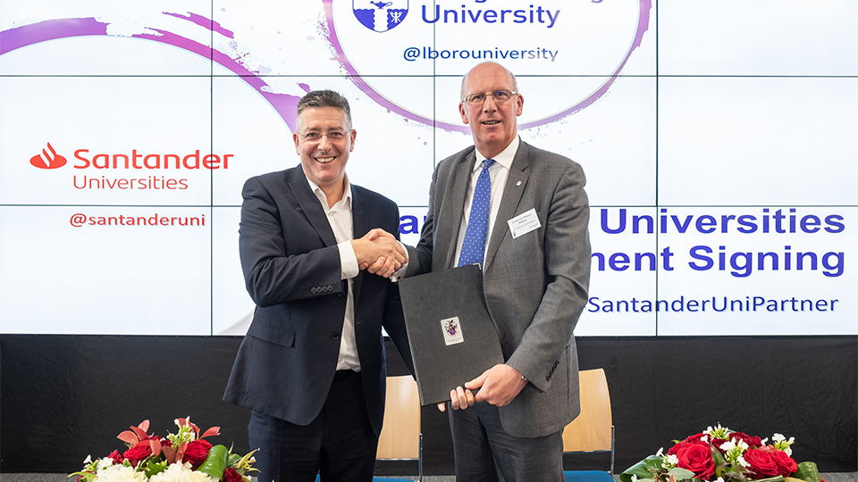 2019 photo of the Vice Chancellor and Director of Santander Universities UK shaking hands at an event at the University