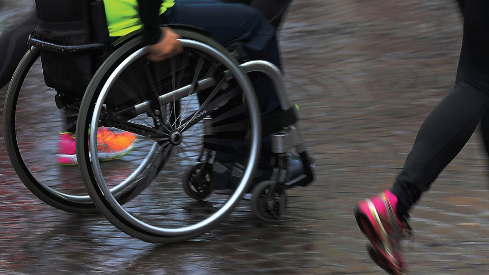 Pictured is a person in a wheelchair and a person running. There is also the National Centre for Sport and Exercise Medicine logo.