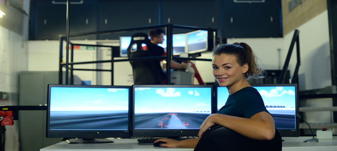 two students using the flight / driving simulator