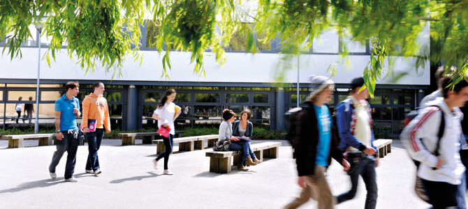groups of students walking on the campus