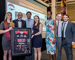 The Dean being presented with a signed jersey by the Leicester Riders Basketball Team
