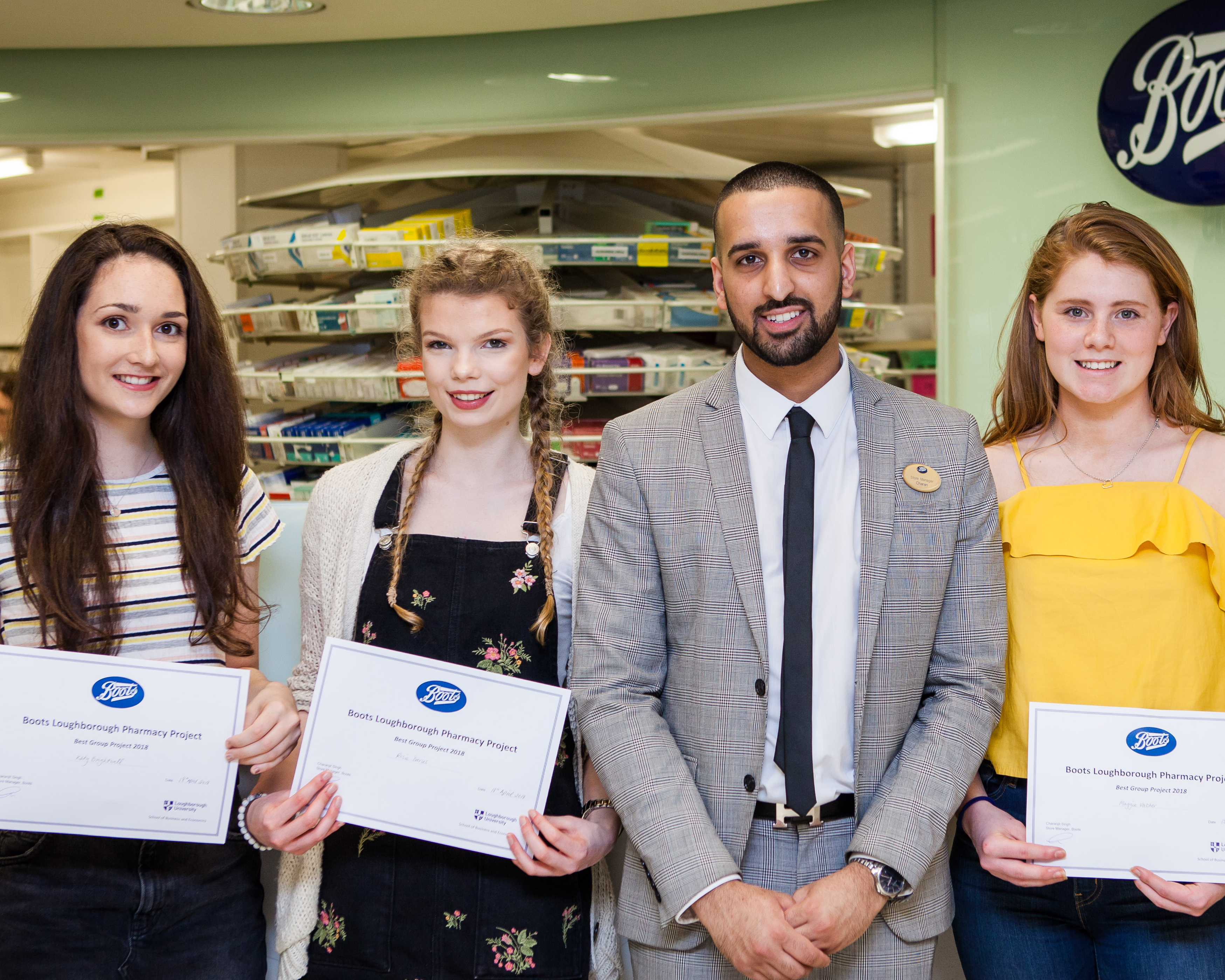 Prize winning students with the Loughborough Boots store manager