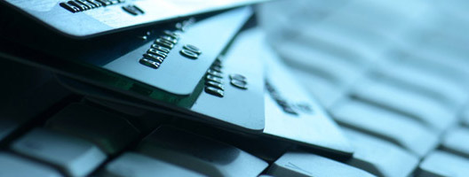 Photo: Credit cards on keyboard.