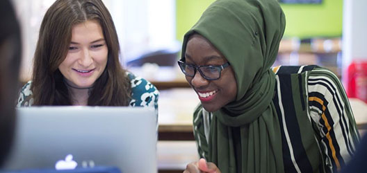 photo of two female students talking