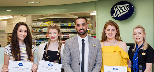 Photo of winning SBE students with Charanjit Singh, Store Manager of the Boots Loughborough store.