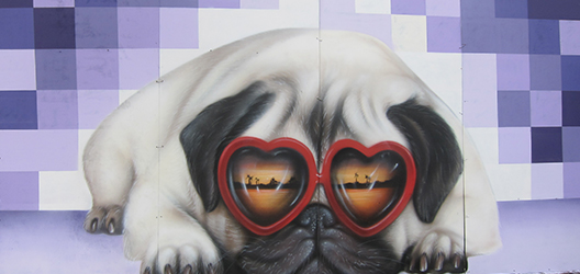 Buber Nebz work of graffiti street art, with a purple background and a pug dog wearing sunglasses