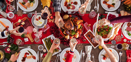 photo of an aerial view of a table with Christmas food and decorations