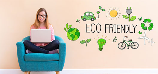 girl sits on chair with laptop, logos representing eco-friendly activities next to her