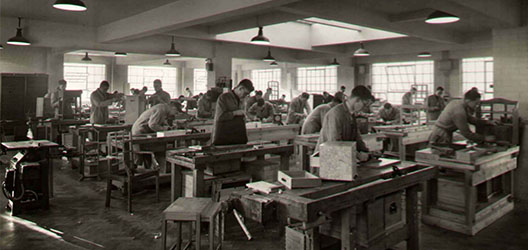 Historical image of furniture being produced at the Handicraft Unit