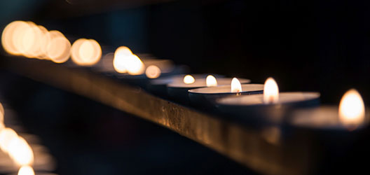 photo of candles burning in a service