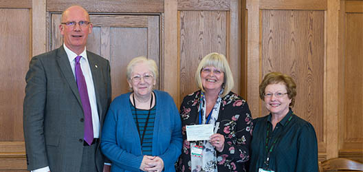 Vice Chancellor presenting cheque to community group