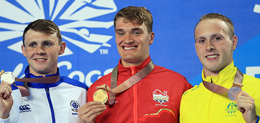Swimmer James Wilby winning gold for 200m breaststroke at the Commonwealth Games