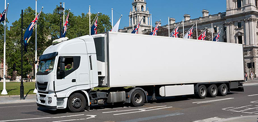 A lorry driving in London.