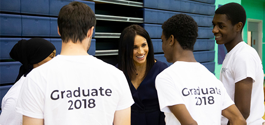 Duchess of Sussex Meghan talking to young coaches at Coach Core event