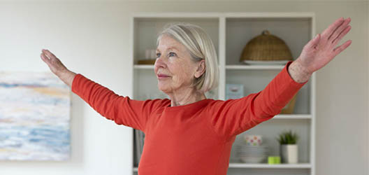 Older woman doing exercise at home