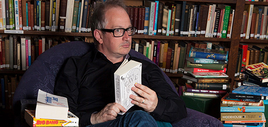 Photo of robin ince sat on a chair