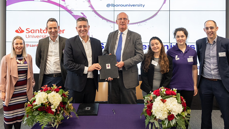 photo of Santander signing with staff and students from the University as well as Santander Universities UK representatives