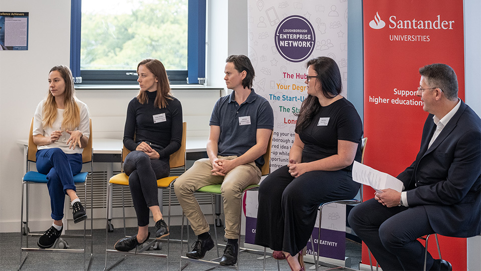 Photo of various alumni on a panel discussion about 'being your best self' as part of the Santander agreement