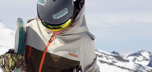 Model wearing Snooks outerwear on ski slope