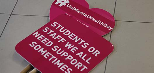 photo of lollipop signs with messages used on University Mental Health Day