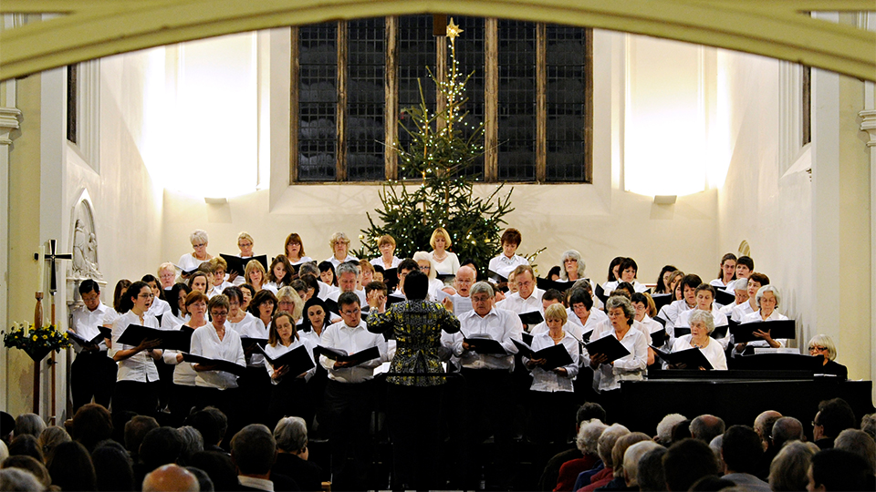 photo of the University Choir performing at previous Xmas concert