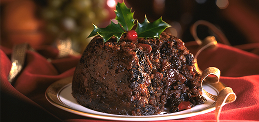 photo of a Christmas pudding with holly on top