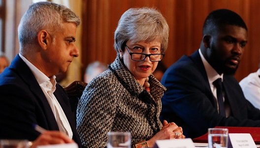 Student Roy Sefa-Attakora is pictured at the Youth Crime Summit with Prime Minister Theresa May and Mayor of London Sadiq Khan.