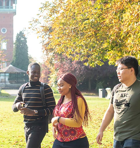 Students walking through Queen's Park in Loughborough