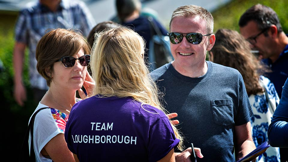 Parents talking to a Team Loughborough student on an open day
