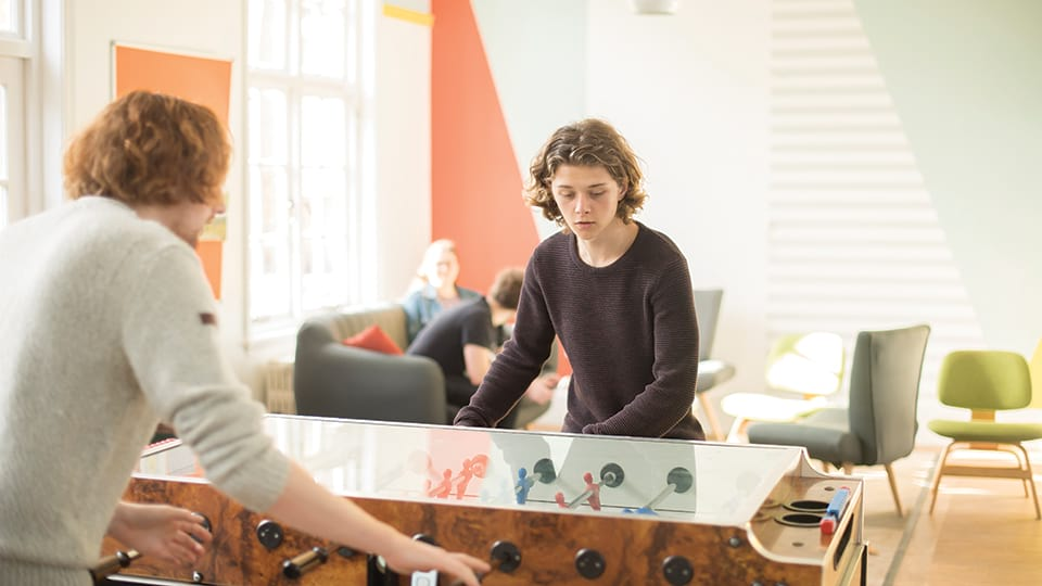Students playing table football in halls of residence
